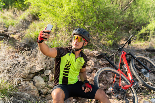 Cyclist posting a selfie on his social media