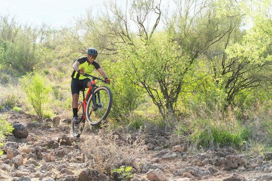 Latin athlete training cycling outdoors