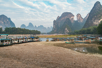 Fototapeta Boats on Li River at sunrise. Yangshuo. Guangxi Province. obraz