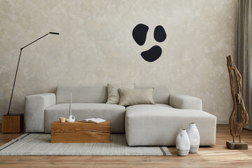 Fototapeta Creative composition of stylish japandi living room with grey sofa, wooden cubes and small personal accesories. Creative wall and parquet floor. Copy space. Template. obraz