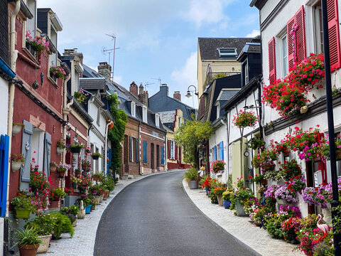 Saint-Valery-sur-Somme, France, August 15, 2020 - Beautiful flowered traditional street Saint-Valery-sur-Somme.