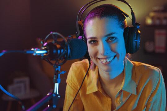 Smiling radio dj posing with headphones