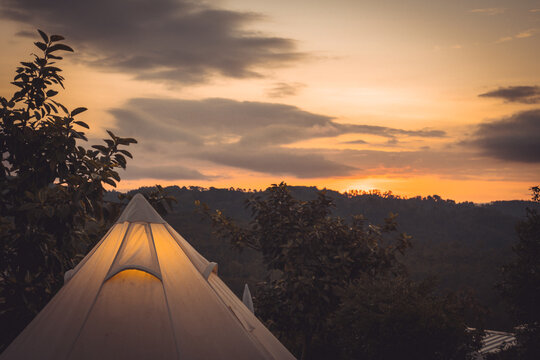 sunrise in morning with camping tent on mountain