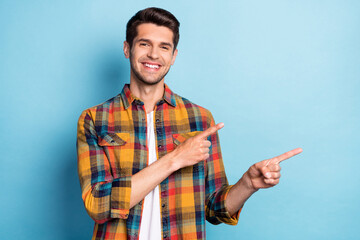 Portrait of attractive cheerful guy demonstrating copy space new novelty like follow isolated over...