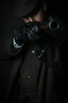 A working class Victorian man holding a gun