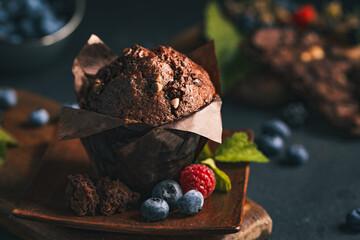 Fototapeta Chocolate muffin. Muffin with chocolate and fruits. Fruit muffin. obraz