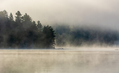 Mist on a great lake in Quebec, Canada in the morning - 448112225