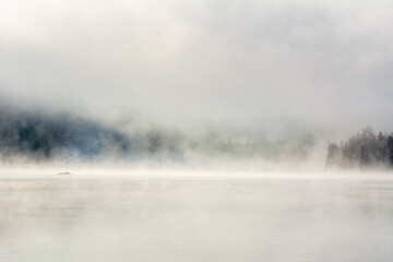 Mist on a great lake in Quebec, Canada in the morning - 448112238