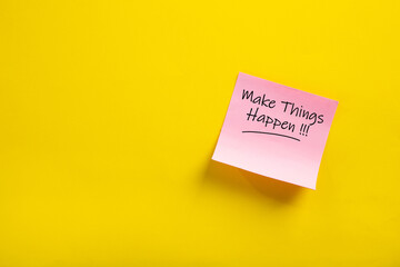 sticky note with make things happen word.
