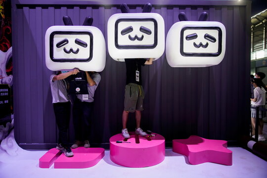 People install a cartoon decoration at the China Digital Entertainment Expo and Conference, also known as ChinaJoy, in Shanghai