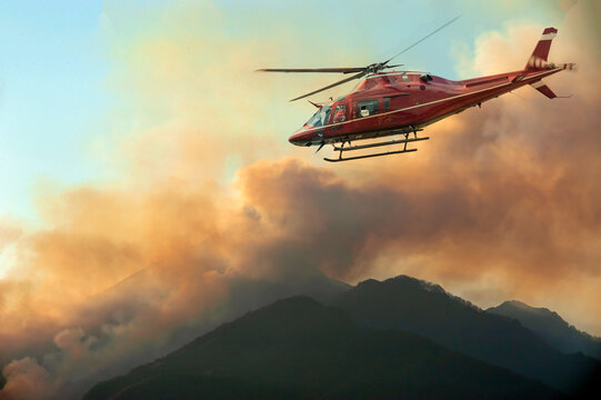 Firefighters helicopter monitor the fire in the mountain