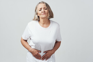 woman is holding her belly diarrhea health problems