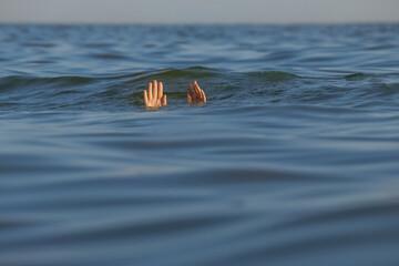 Fototapeta Drowning woman reaching for help in sea obraz