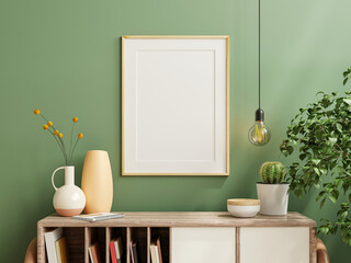 Mockup photo frame green wall mounted on the wooden cabinet with beautiful plants.