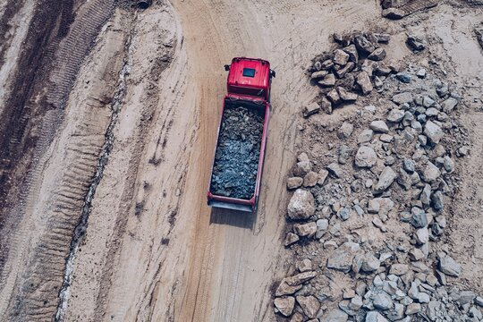 Aerial drone view of tipper truck at the construction site.