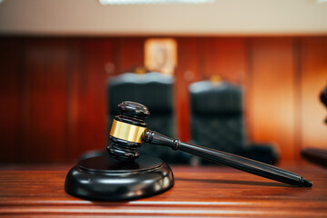 Wooden court gavel on wood table in courtroom,judge and trial. Auction. Law and Justice, Legality concept, Judge.