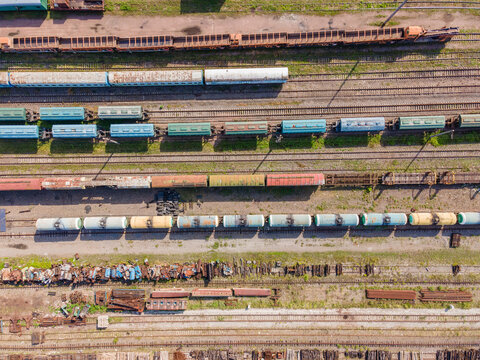 Lots of old railway tracks, trains at the old station, top view