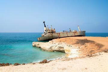 Abandoned ship Edro III near Cyprus beach. Rusty ship ran aground near the shore. High quality photo
