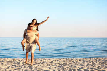 Happy young couple on sea beach