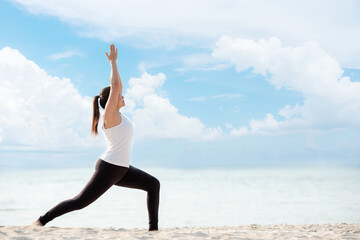 Lifestyle athletic woman yoga exercise and pose for healthy life. Young girl or people pose balance body vital zen and meditation workout and fitness sport outdoor on sand beach