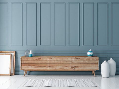 Modern wooden commode or tv console mockup in empty room with gray blue wall