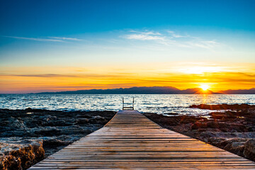 View Wooden jetty on the sea, Peloponnes Greece