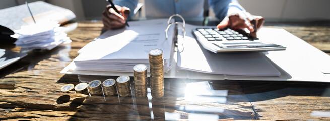African Accountant Using Calculator. Tax Money