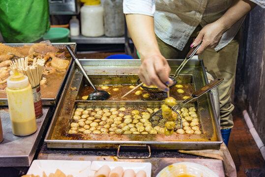 Street food stall at night in Hong Kong