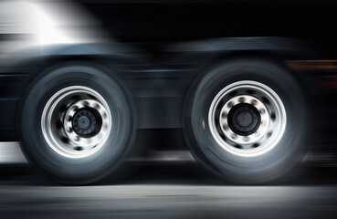Speed Motion Blur of Semi Truck Wheels Spininng. Truck Driving on  The Road. Industry Freight Truck Transport.