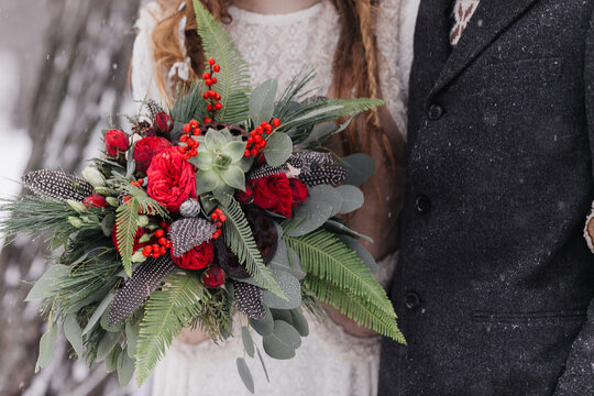 bright bouquet with red flowers bouquet for winter wedding. High quality photo
