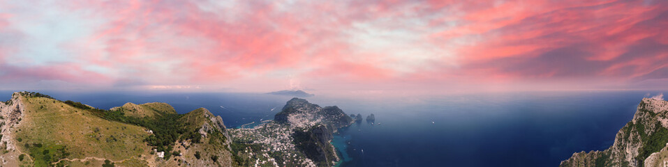 Amazing aerial view of Capri at sunset from a drone flying over Mt Solaro in Anacapri.