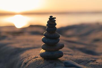 Zen Stones Stacked on the Beach at Sunset Golden Light Meditation Cairn