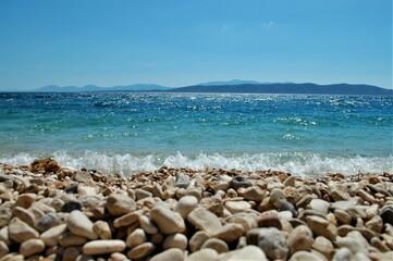 Obraz plaża, kamienie, woda - fototapety do salonu