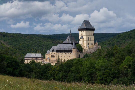 Karlstejn Castle, historical building of the Czech Republic in the summer blooming scenery. Popular tourist destination/attraction near Prague.