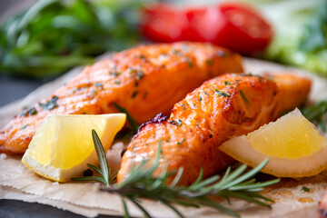 Cooked salmon fish fillet with lemon and rosemary