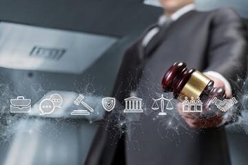 Lawyer holding judge gavel on legal icons background.