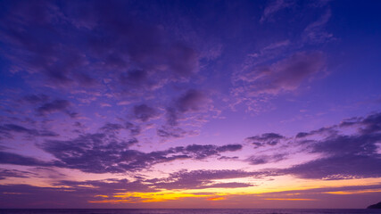 Majestic sunset or sunrise landscape Amazing light of nature cloudscape sky and Clouds moving away rolling colorful dark sunset clouds with reflection in water sea surface Amazing view.