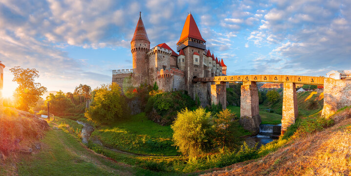 hunedoara, romania - OCT 13, 2019: corvin castle at sunrise. panoramic view of medieval fortification in morning light. one of the most beautiful landmarks in transylvania. popular travel destination