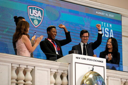 Ashleigh Johnson, Goalkeeper for the U.S. Olympic Women's Water Polo Team rings the opening bell at the New York Stock Exchange (NYSE) in Manhattan, New York City