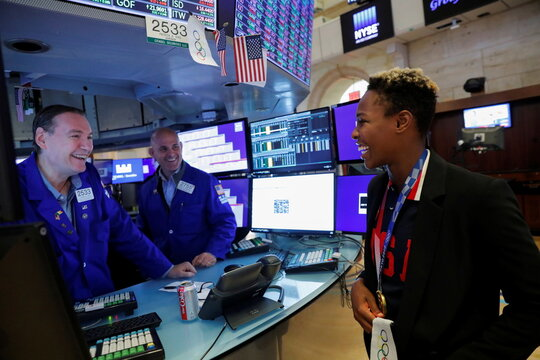 Ashleigh Johnson, Goalkeeper for the U.S. Olympic Women's Water Polo Team and Tokyo 2020 Olympic gold medalist greets traders after ringing the opening bell at the New York Stock Exchange (NYSE) in Manhattan