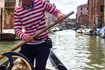 Gondolier in a Venice canal close-up