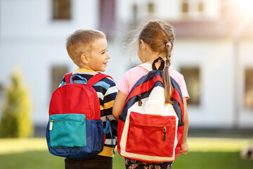 Children with backpacks going to the school