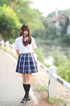 beautiful asian japanese school girl uniform looking at park outdoor