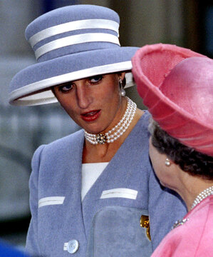 The Princess of Wales chats to Queen Elizabeth II at St Margaret's Church, Westminster October 8..