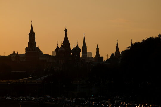St. Basil's Cathedral and towers of Kremlin are silhouetted against the sunset in Moscow