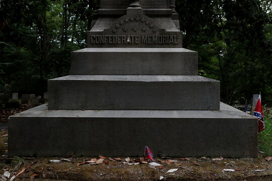 Flags are seen placed at the base of the Confederate Memorial at the Maple Hill Cemetery in Helena, Arkansas