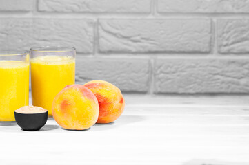 Peach and Maca Smoothie on white brick background, horizontal resolution, Copy Space, Juicy Trendy Food