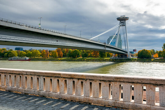 bratislava, slovakia - OCT 16, 2019: bridge through danube. sunny weather with clouds on the sky. cityscape of slovakian capital in autumn. view from the downtown side of the river