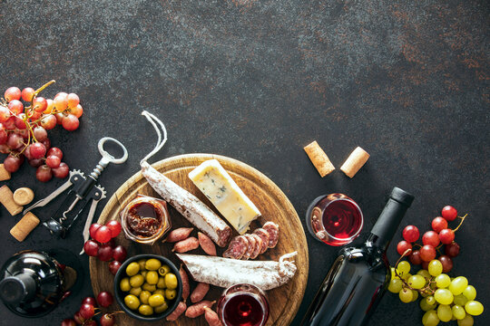 Wine tasting set with a charcuterie board, top-down view