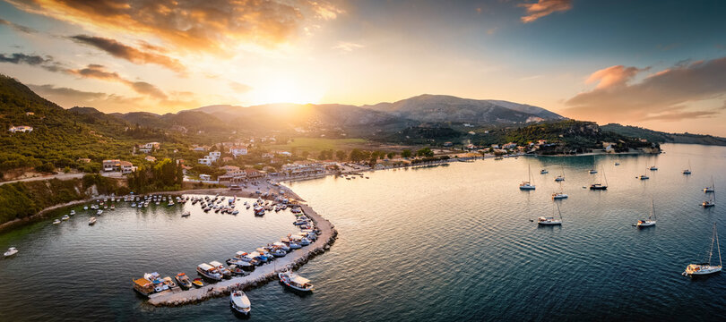 View over the marina to the beautiful village of Limni Keri, Zakynthos, Greece, during a summer sunset